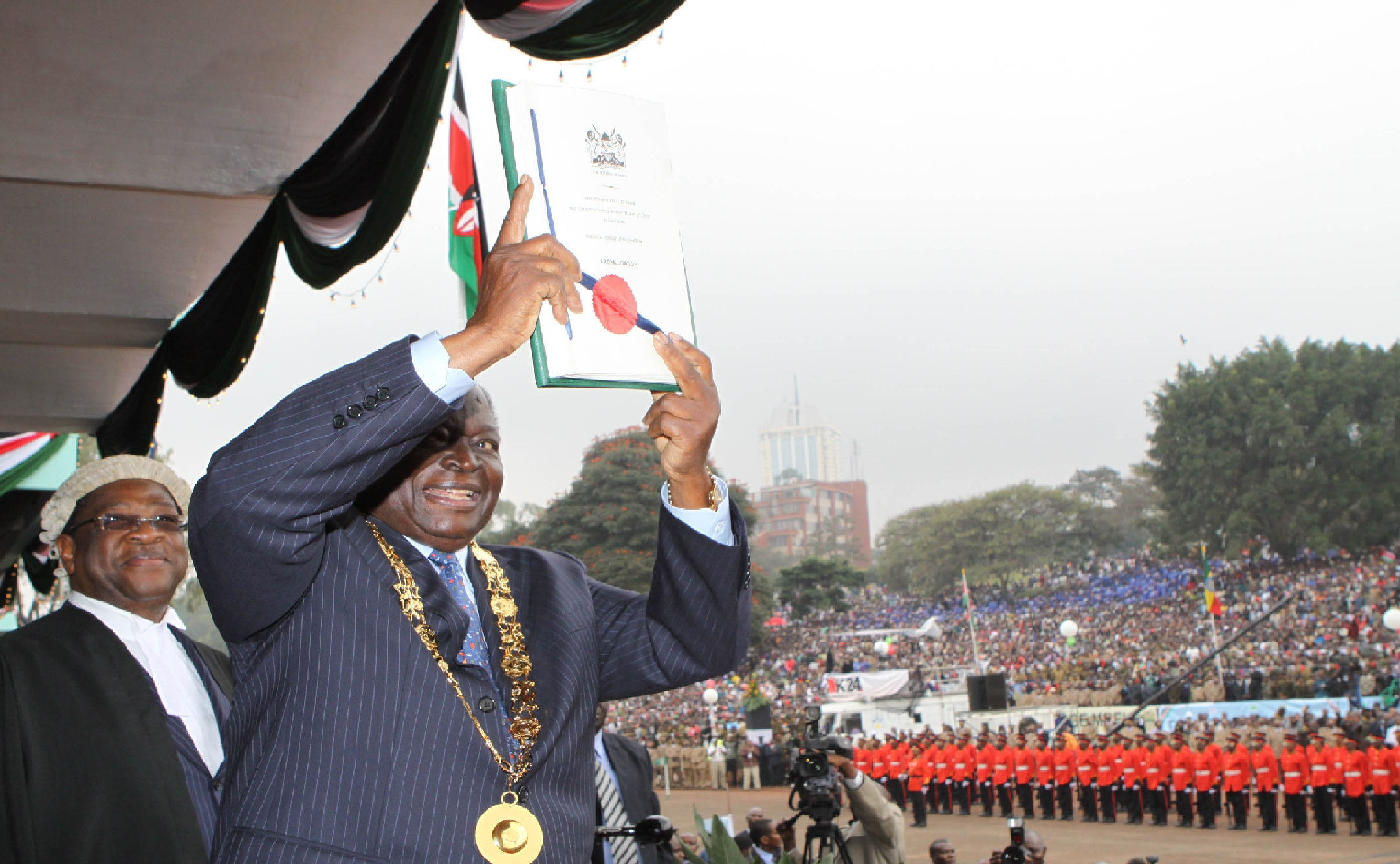 President Mwabi Kibaki displays the new Kenyan constitution